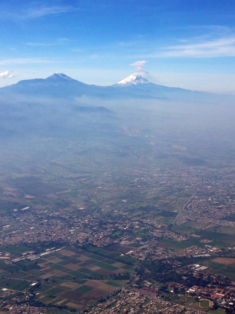 Popocatépetl volcano's plume, from the window of a airplane departing Mexico City the first week of July.