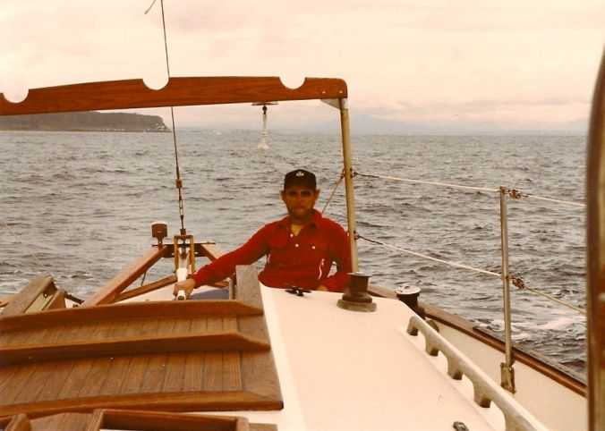 Blue water sailing. This shot is heading out of San Diego -- Point Loma in the background. 1983.