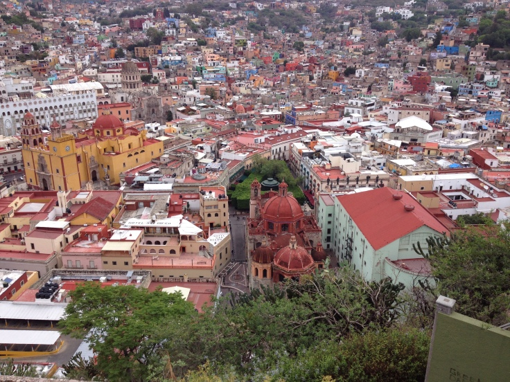 View looking down onto the center of Guanajuato. That cheese wedge patch of green in the center is the Zocalo, or El Jardin, the tiniest promenade I've ever seen, and the most European.
