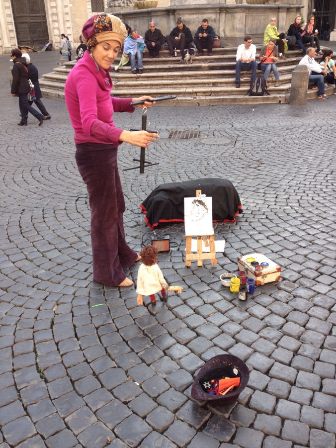The puppet painter of the Piazza S. Maria in Trastevere.